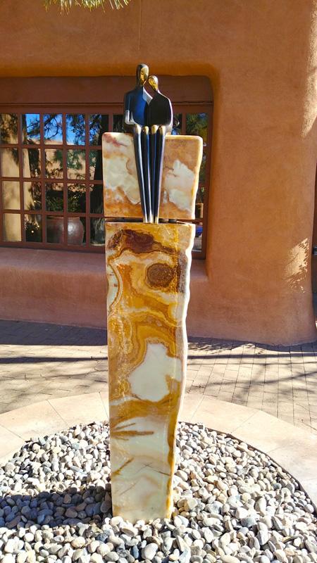 stone fountain water feature bronze sculpture Loretto Santa Fe